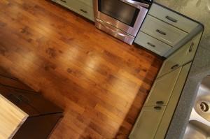 green-kitchen-cabinets-hardwood-floor-south-falls-construction