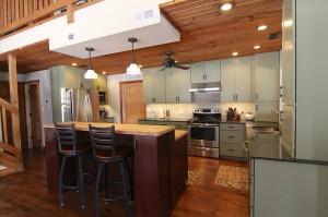 green-kitchen-island-bar-stools-south-falls-construction