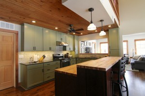 green-kitchen-island-family-room-south-falls-construction