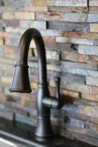 kitchen-rubbed-bronze-faucet-south-falls-construction